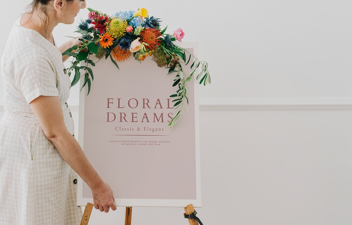 Woman standing by a floral dreams frame mockup