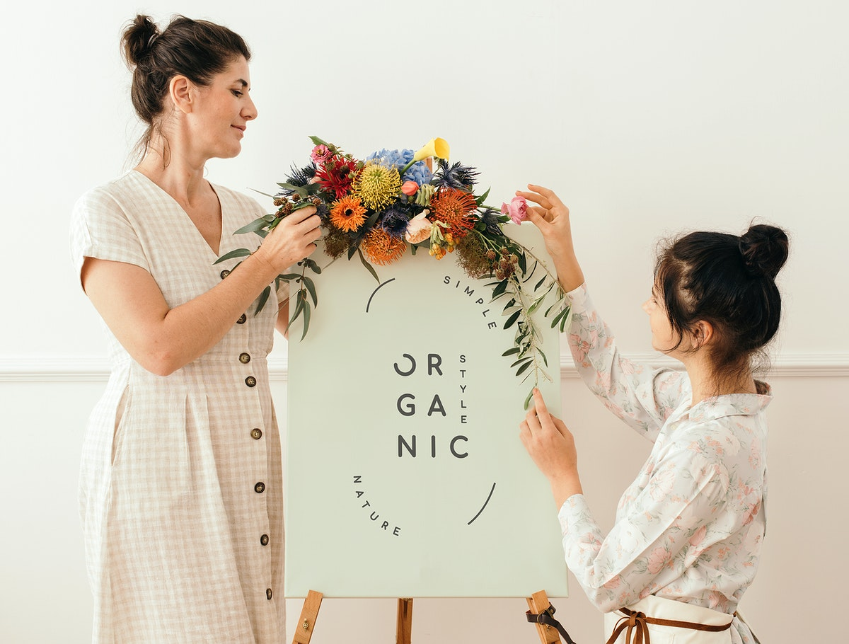 Women standing by a floral organic frame mockup