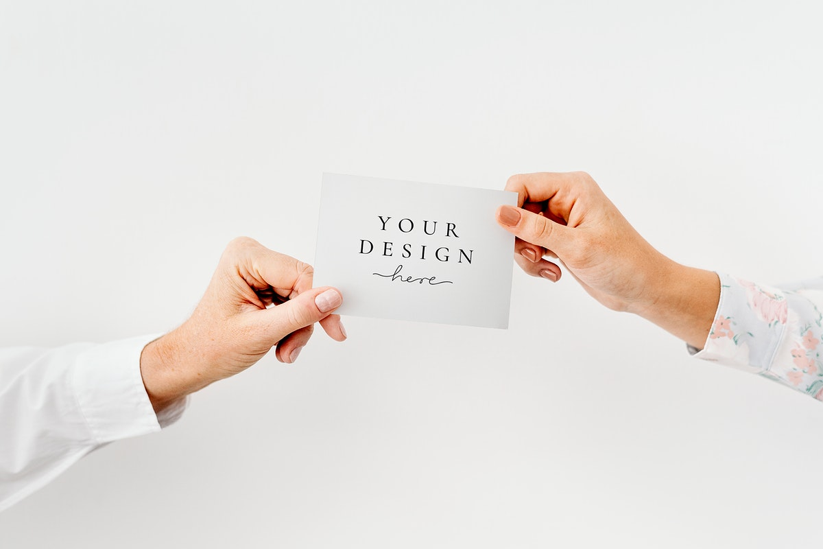 Hands holding a white card mockup