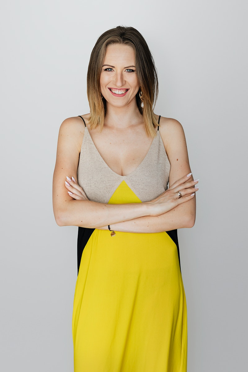 Cheerful woman in a yellow dress