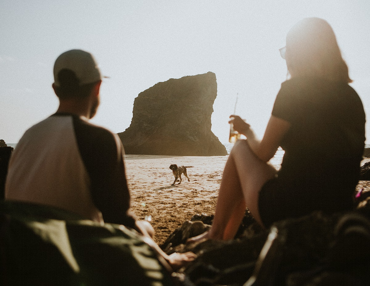 Friends enjoying at the beach with a dog