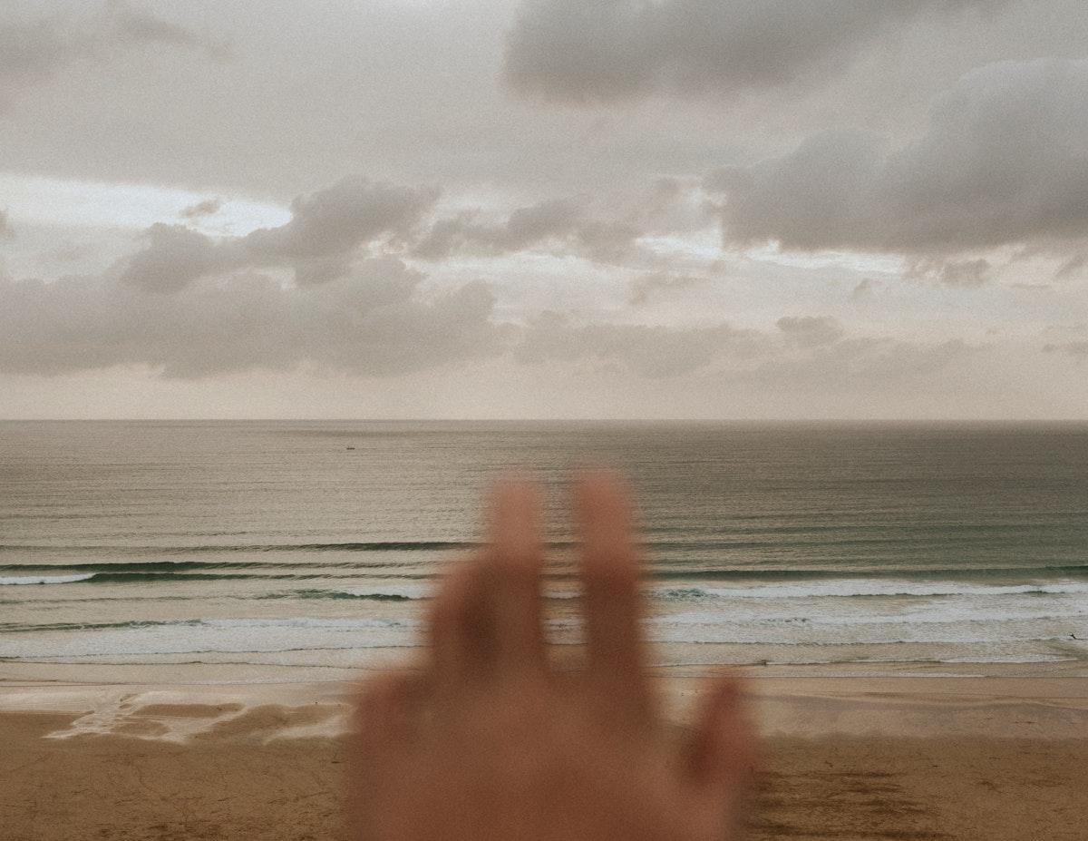 Hand over the calm ocean