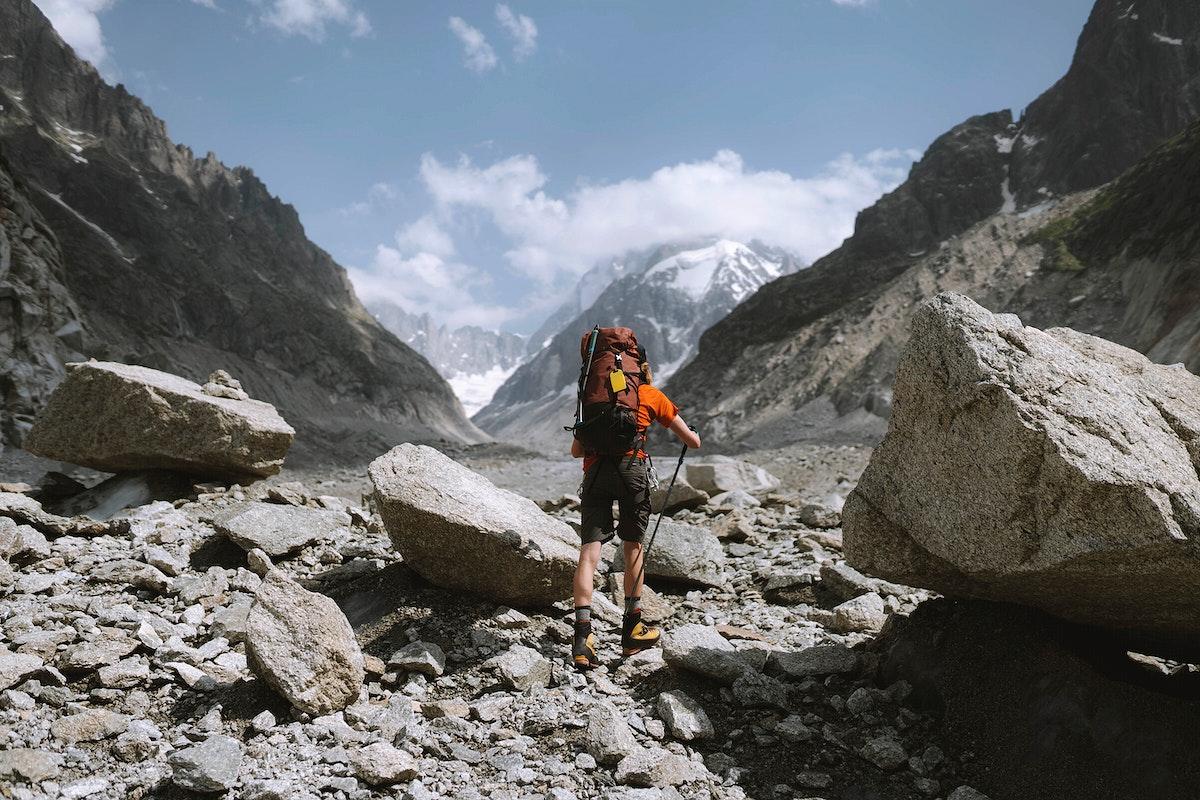 Hiker walking up Chamonix Alps in France