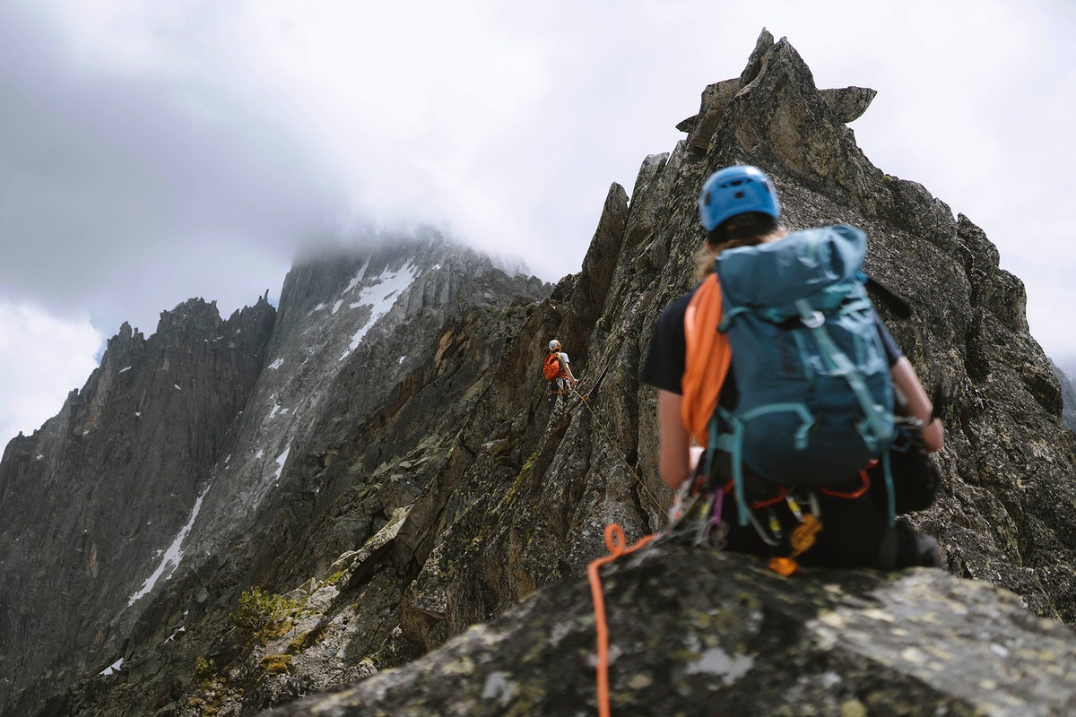 Backpackers zip lining through Chamonix Alps in France