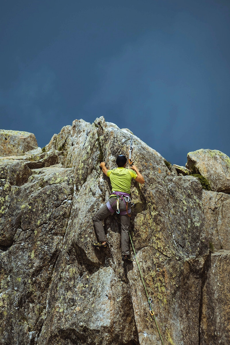 Rock climber working his way up  Chamonix Alps in France