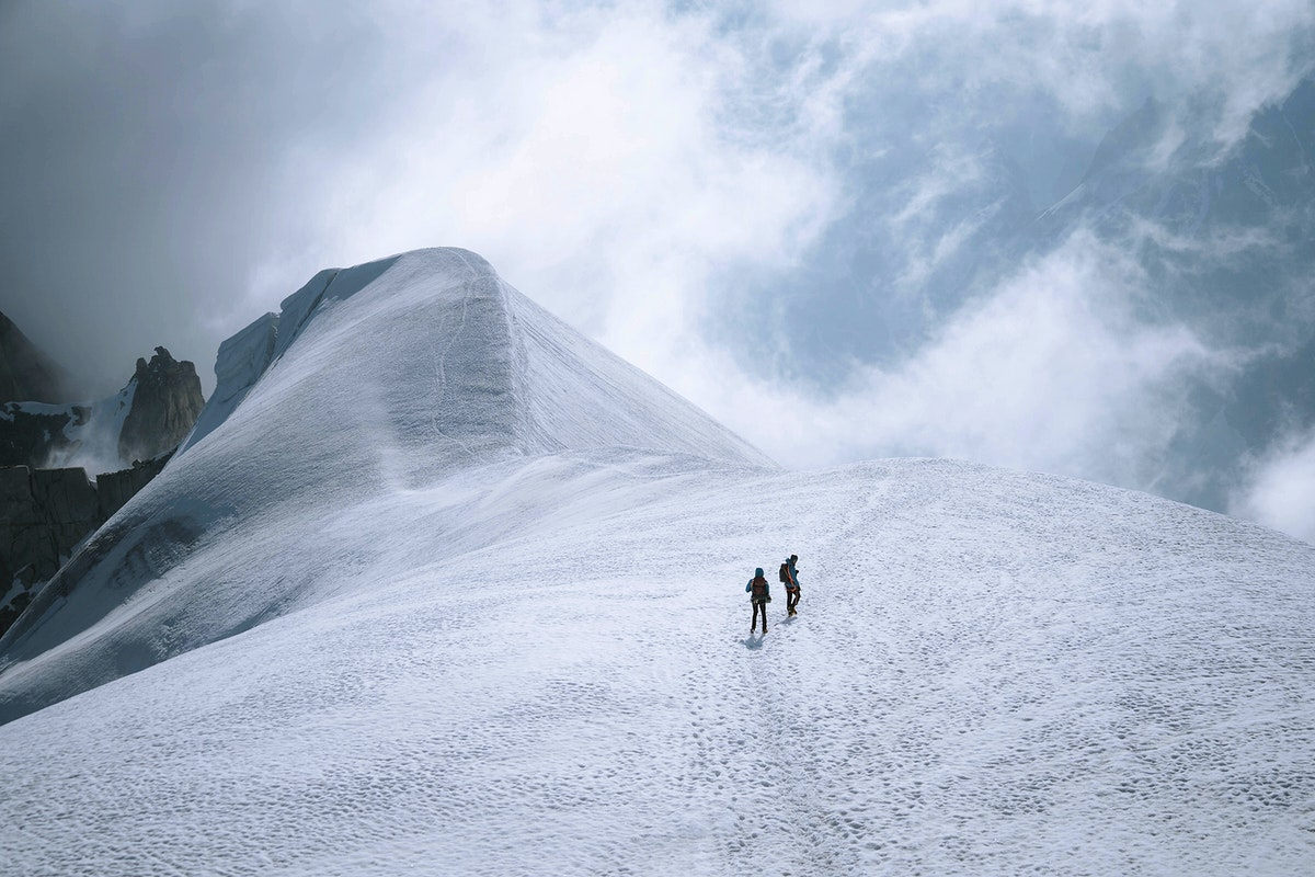 Hikers going up Chamonix Alps in France