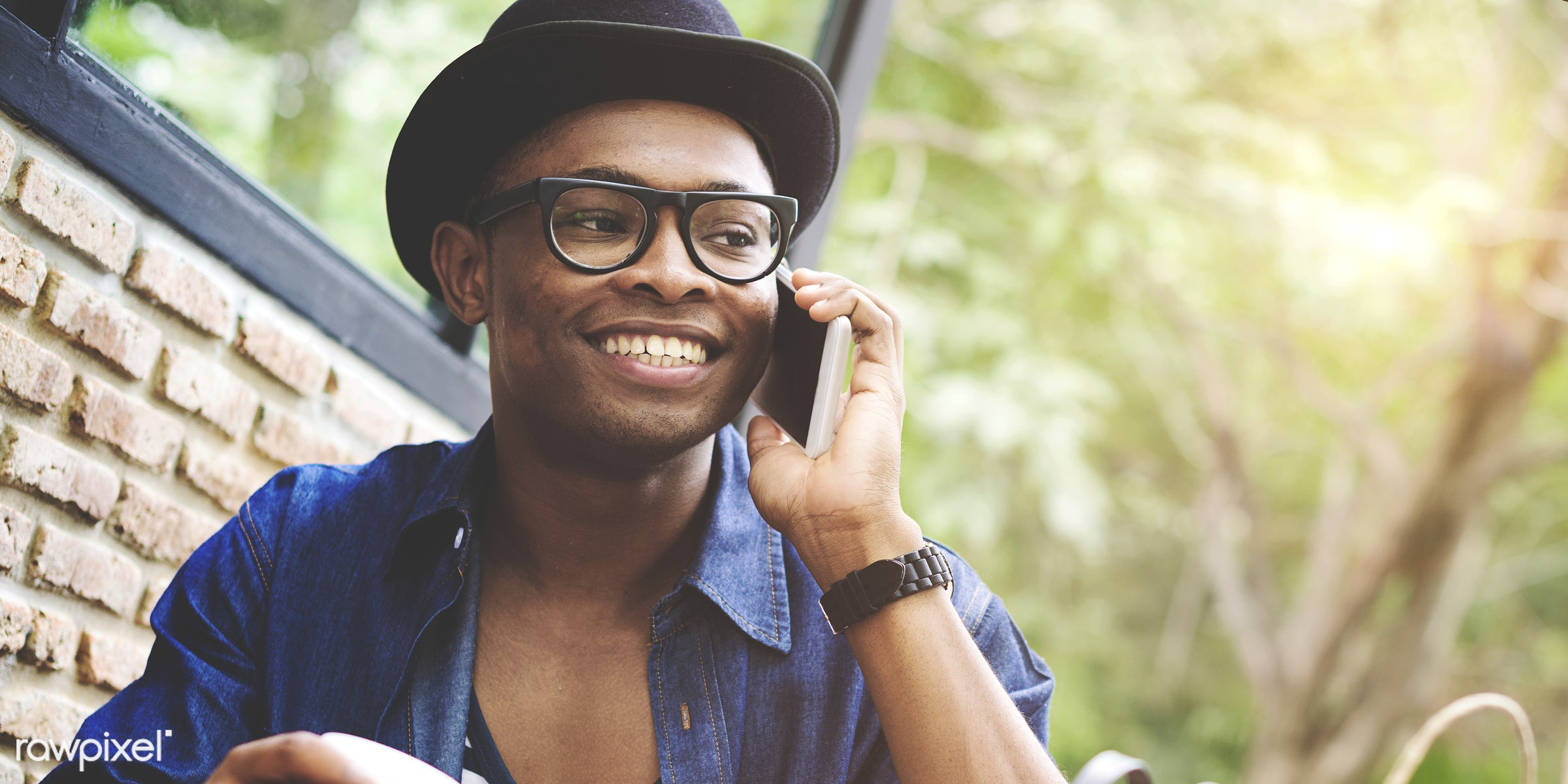 on the phone, smiling, happy, fashion, outdoor cafe, african, smile, happiness, enjoyment, calling, call