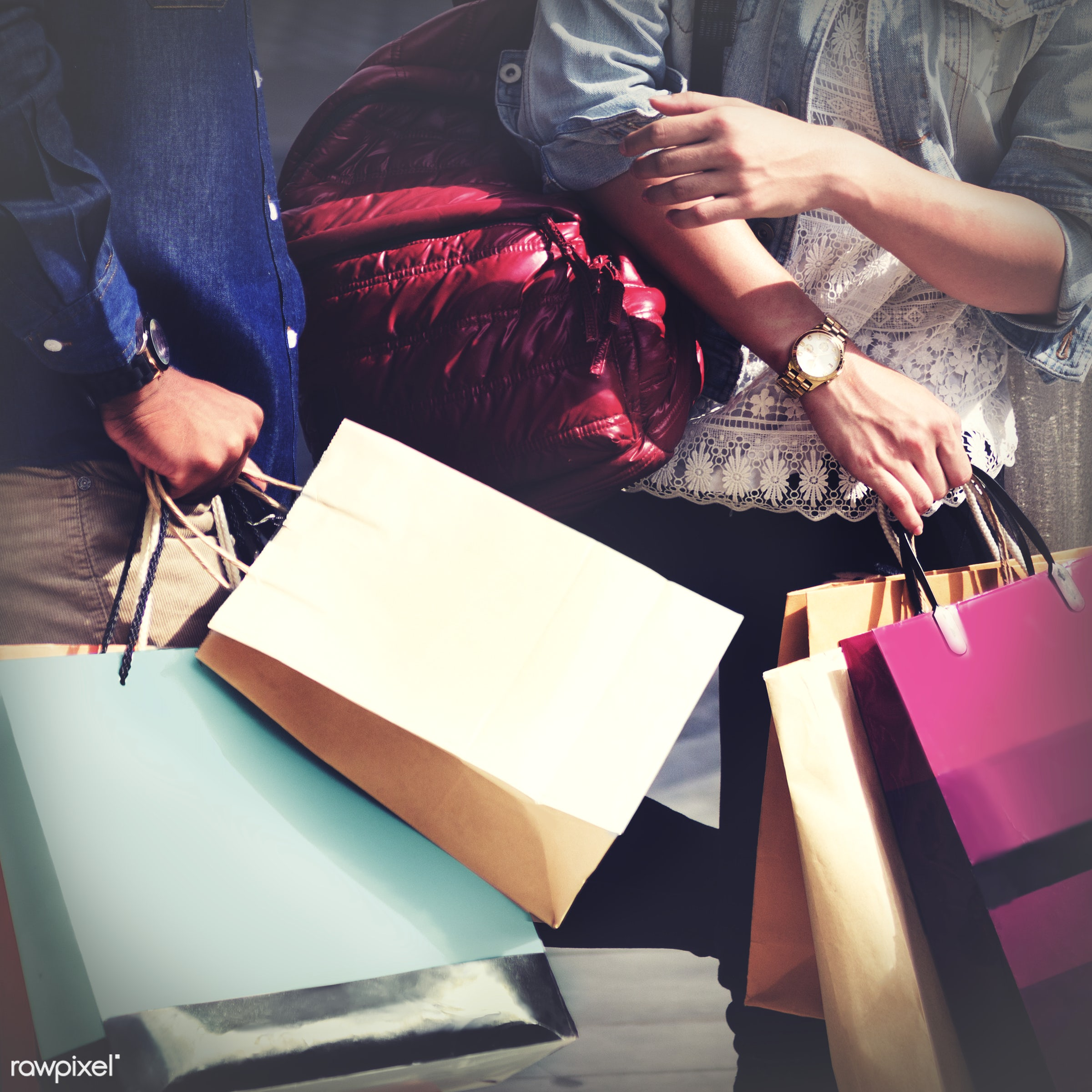 Close up of a two people holding a bunch of shopping bags - shop, shopping, fun, happy, enjoy, enjoyment, together, bonding...