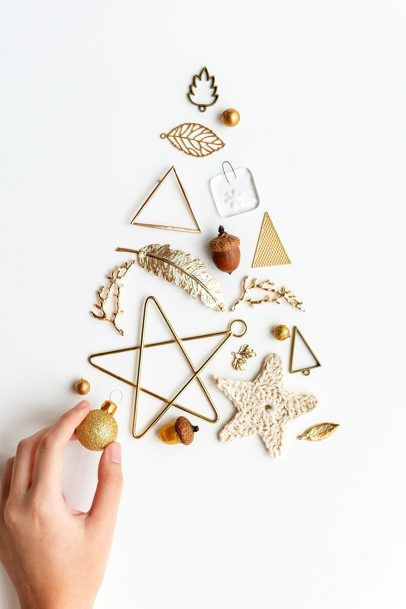 Woman making a Christmas tree with gold ornaments aerial view