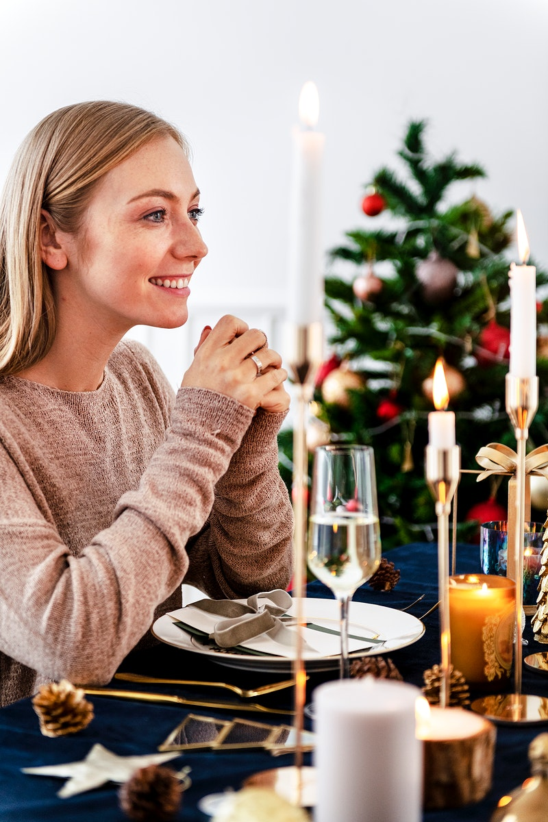 Blond woman having a romantic Christmas dinner