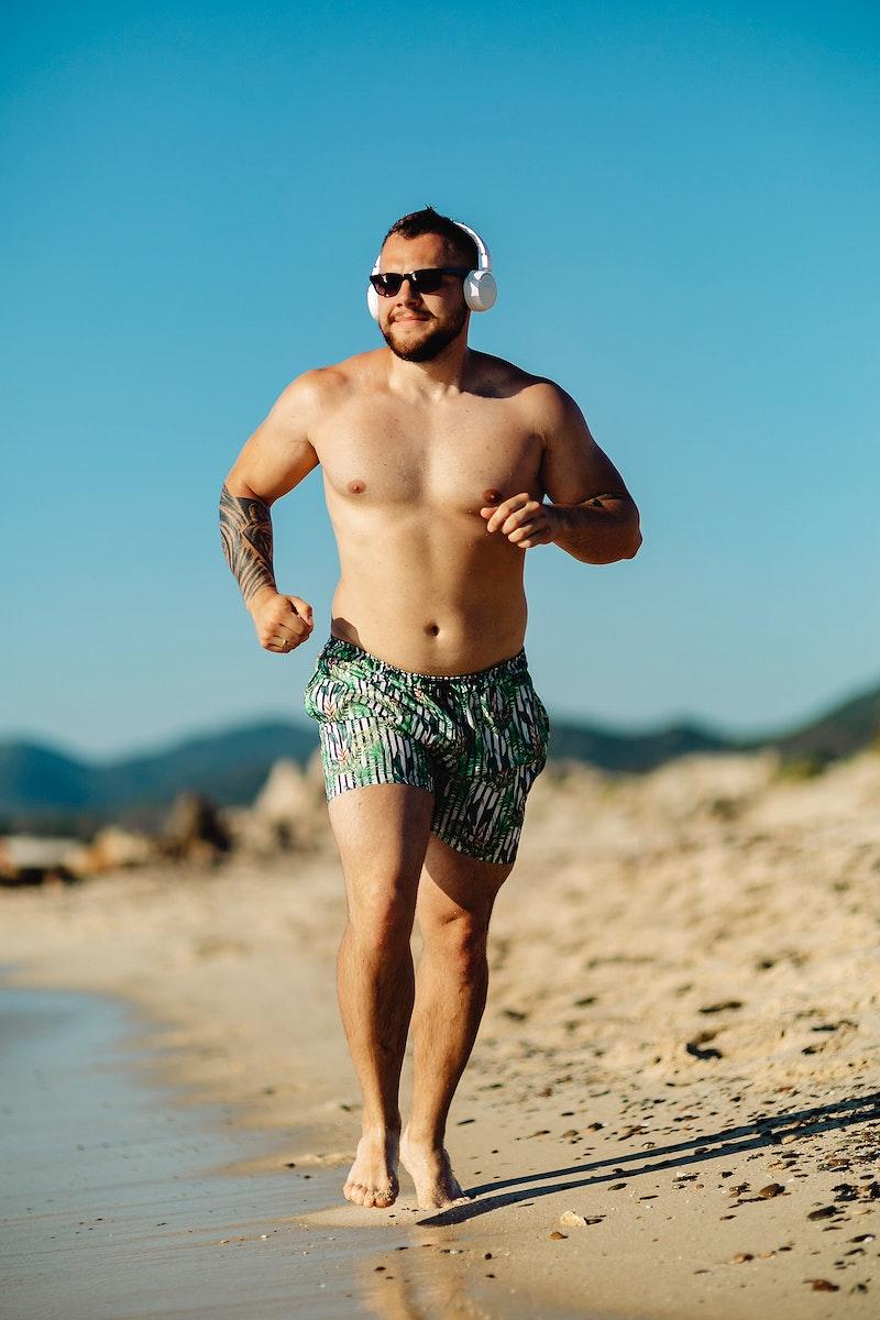 Man jogging along the beach