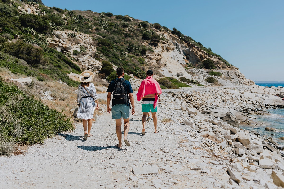 Group of friends walking to the beach