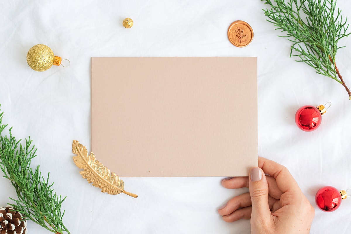 Woman holding a greeting card mockup