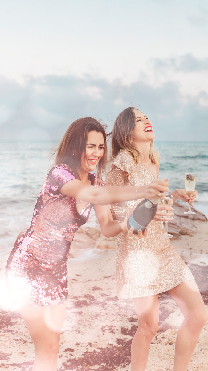 Women with champagne at the beach with bokeh effect mobile phone wallpaper