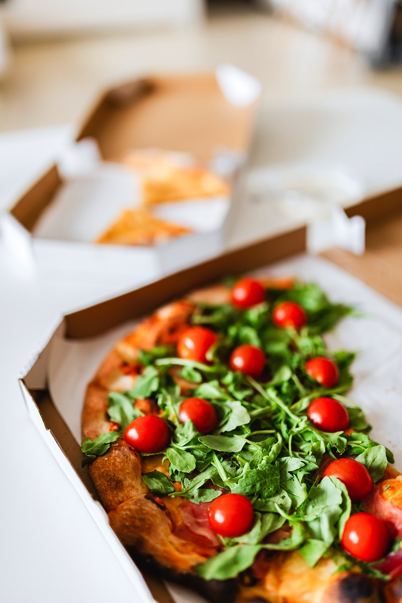 Slices of rocket and tomato pizza