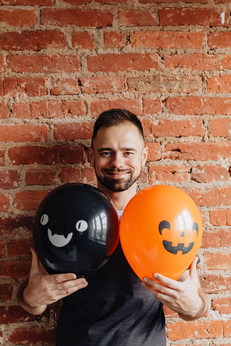Man with cute Halloween balloons