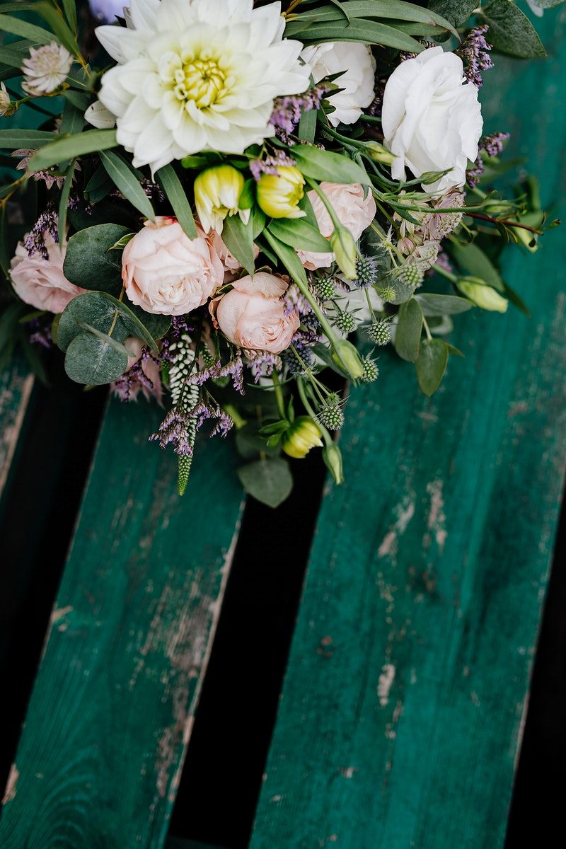 Bouquet of pastel flowers on a wooden table