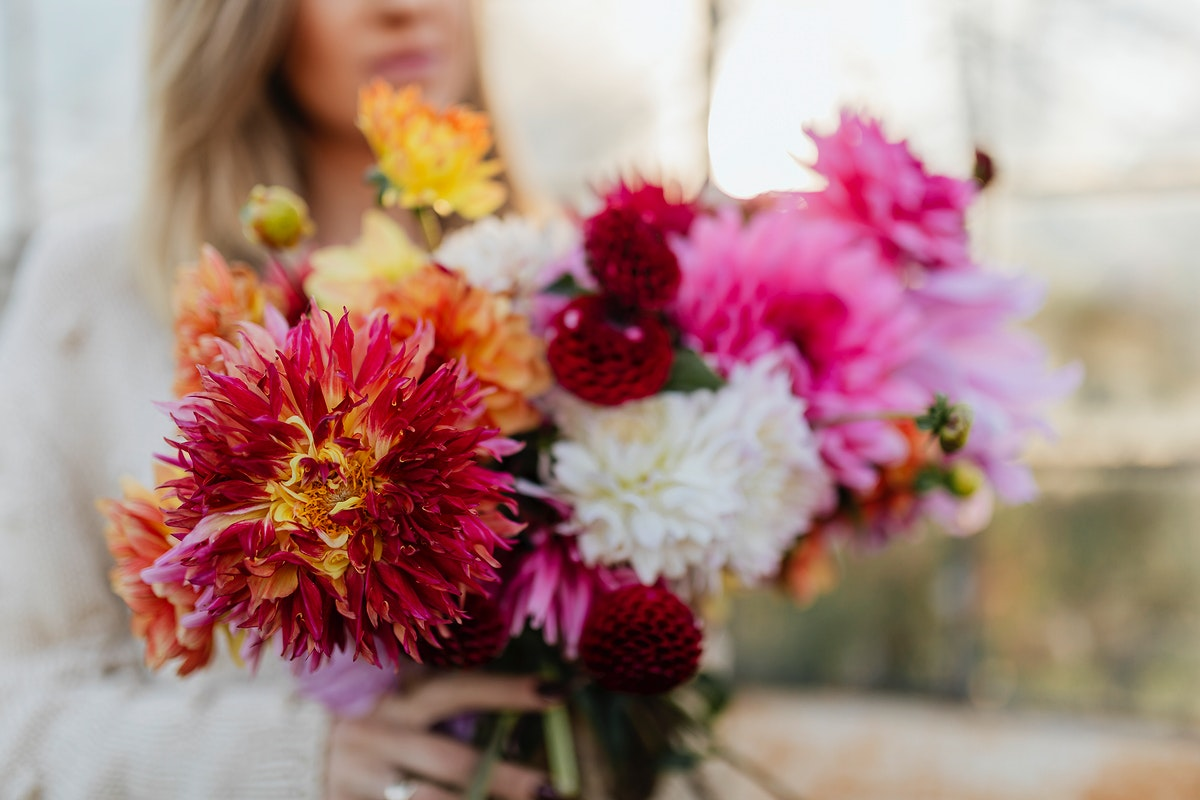 Woman holding a bouquet of beautiful flowers