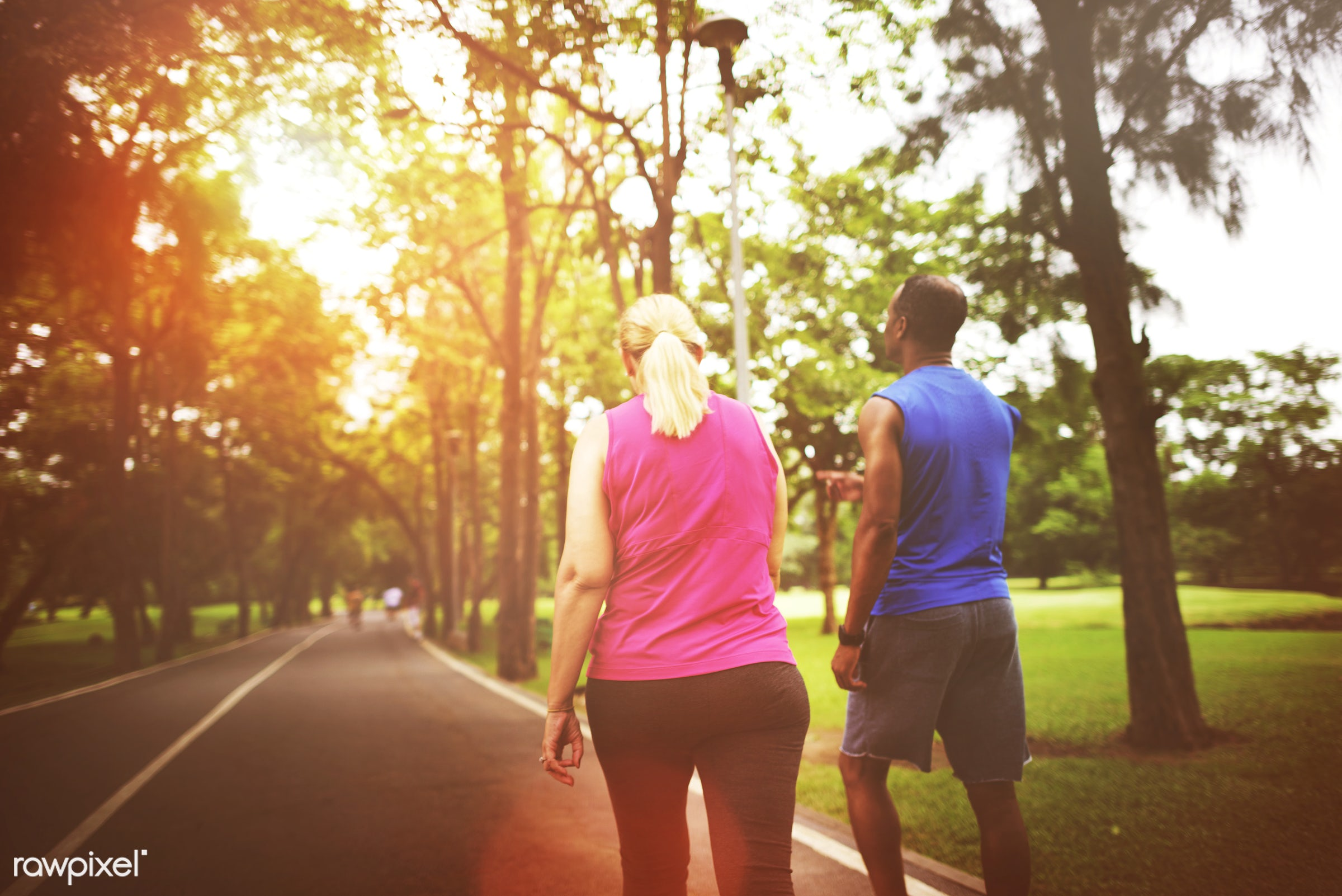 Couple running together at a park - fitness, active, activity, app, application, athlete, body building, cardio, cheerful,...