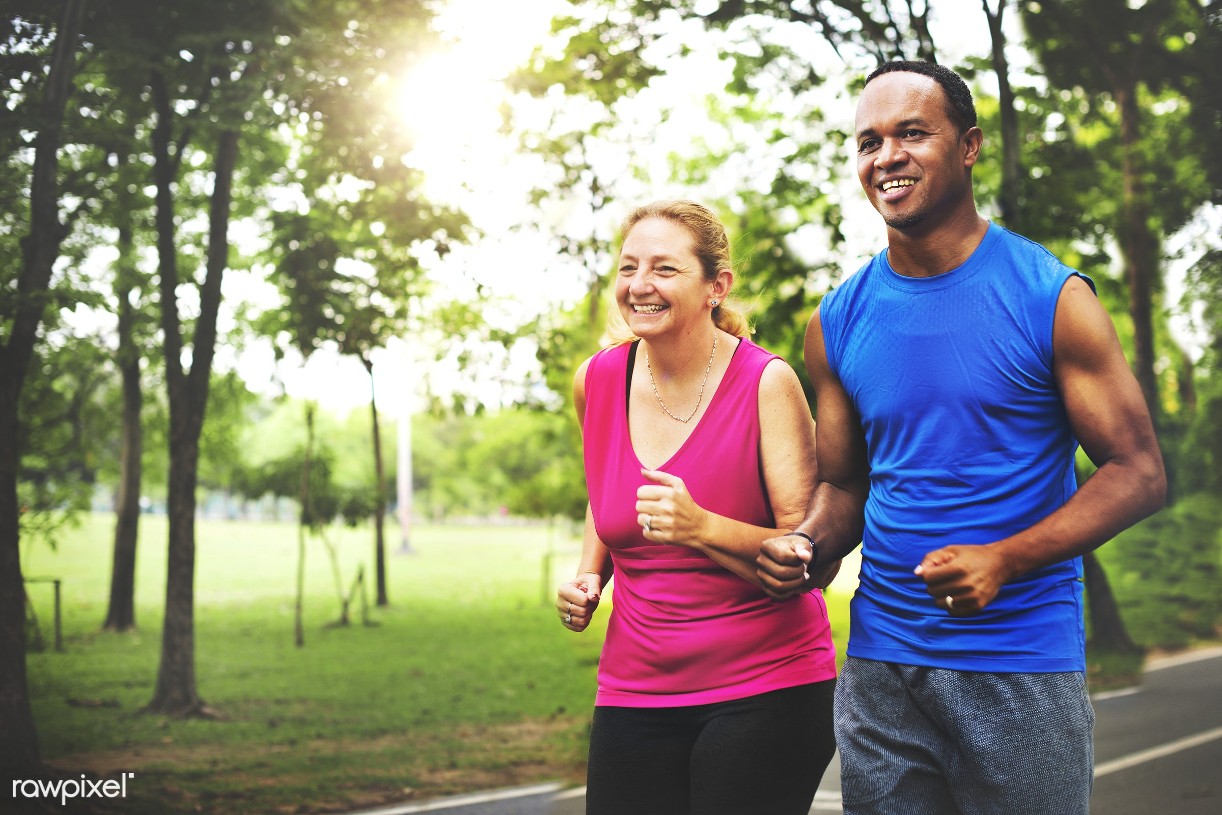 Sporty senior woman and a young man jogging together - african, african descent, cheerful, clothing, coach, coaching, couple...