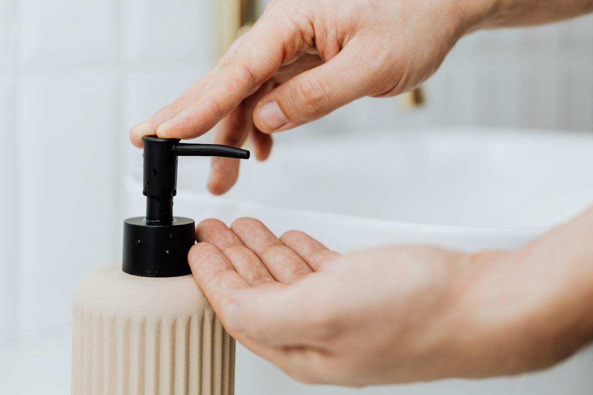 Man using a soap dispenser