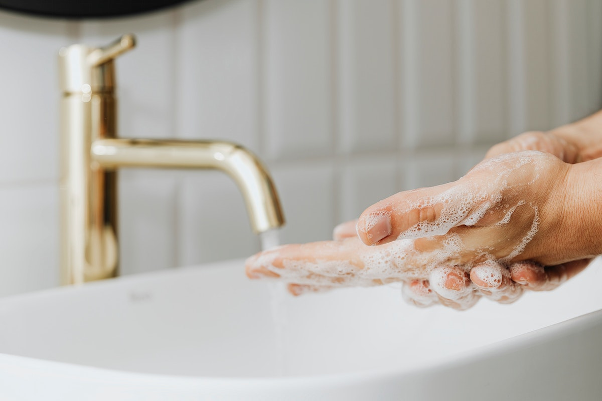 Man washing his hands with soap
