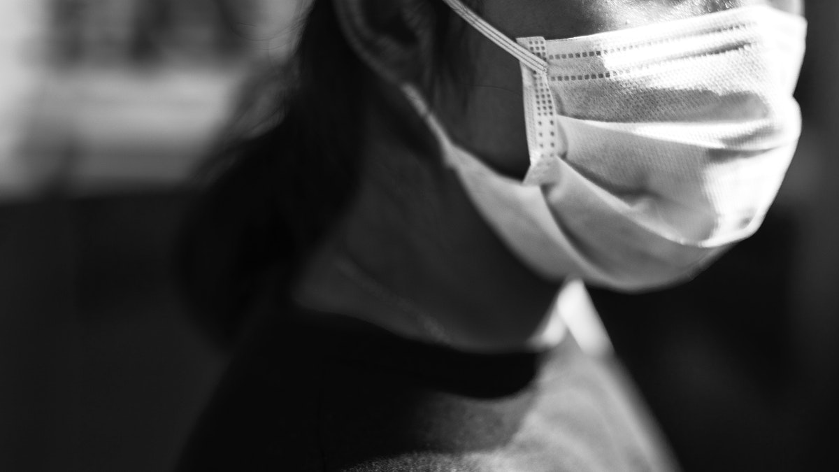 Woman wearing a face mask in public to prevent coronavirus infection