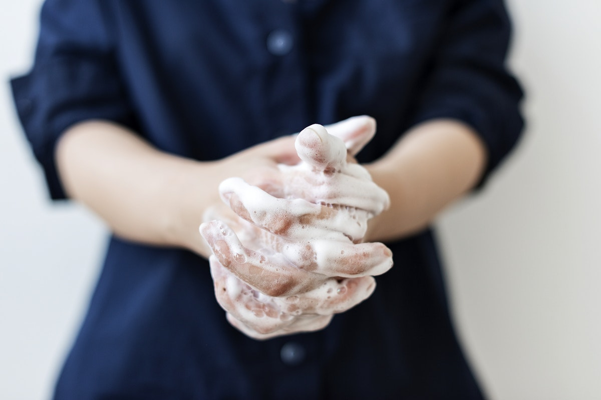 Washing hands with soap to prevent coronavirus contamination