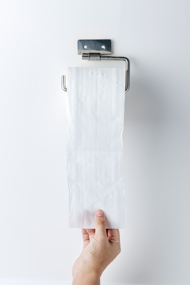 Hand getting toilet paper