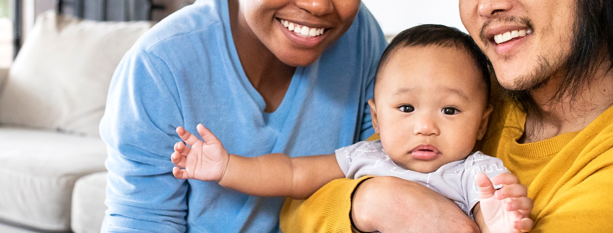 Happy multiracial parents with son social media banner