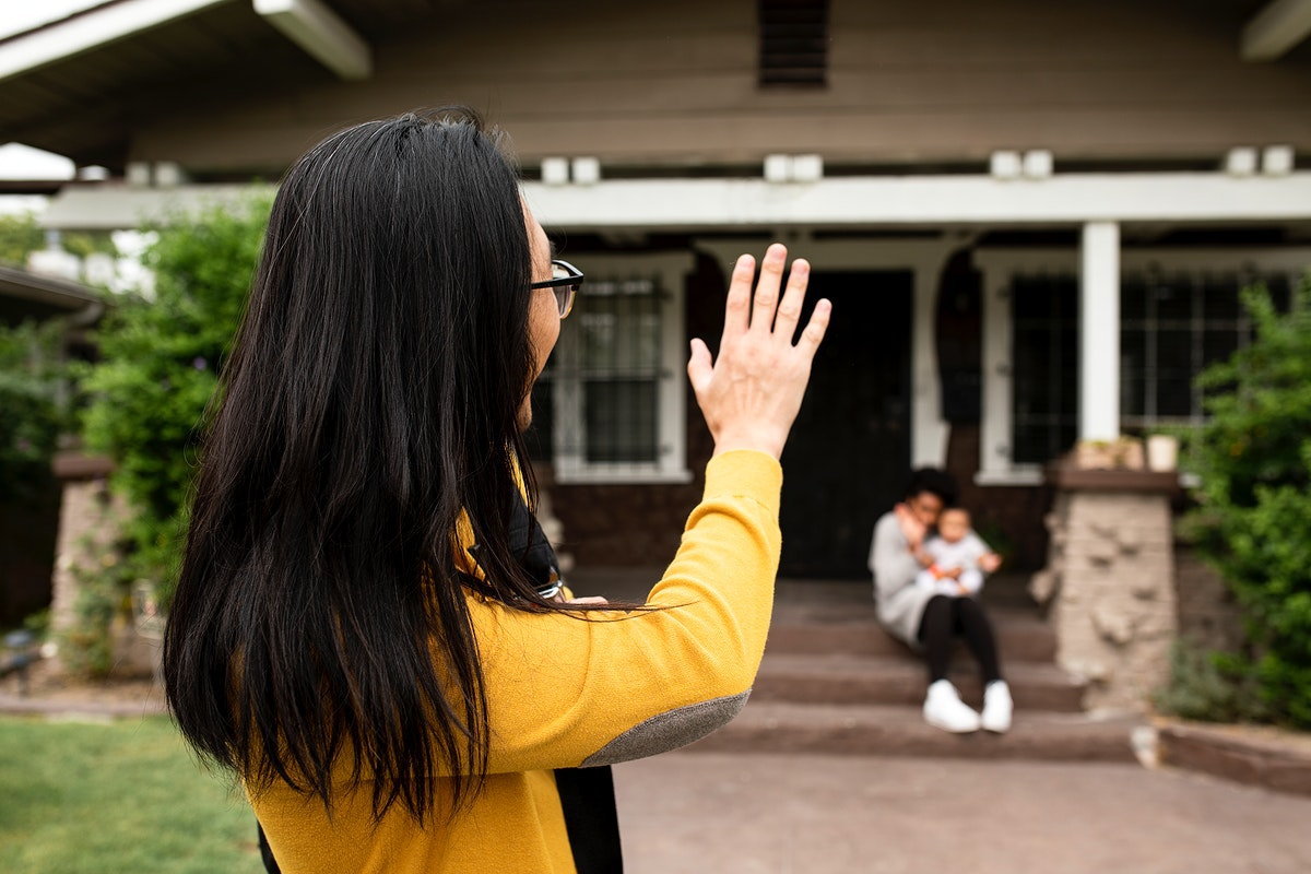 Asian father saying goodbye to his family