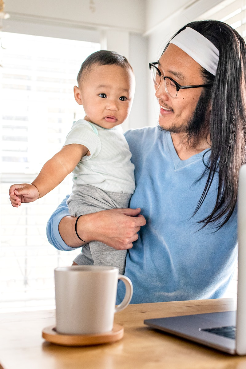 Father working from home with kid  in the new normal