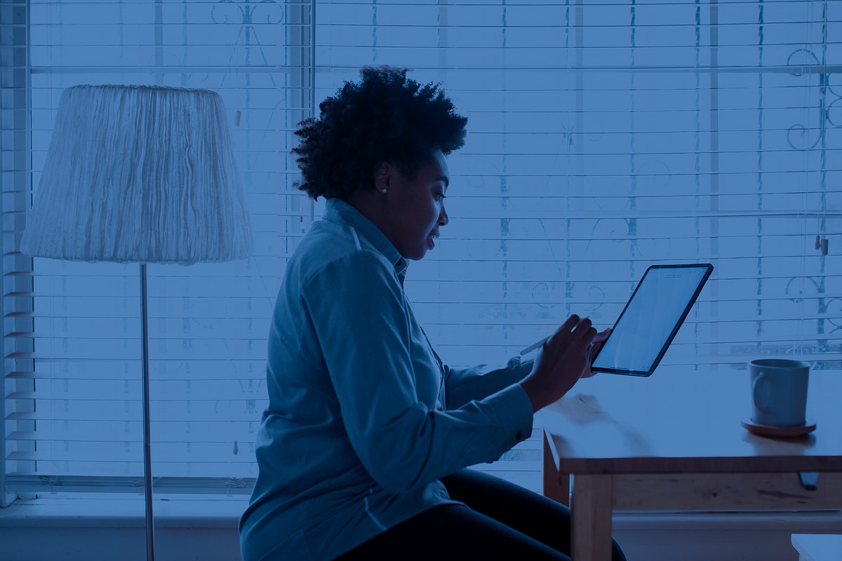 Woman working remotely technology background
