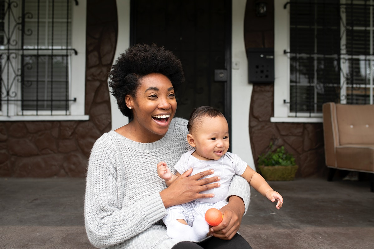 Cheerful African American mother with her son