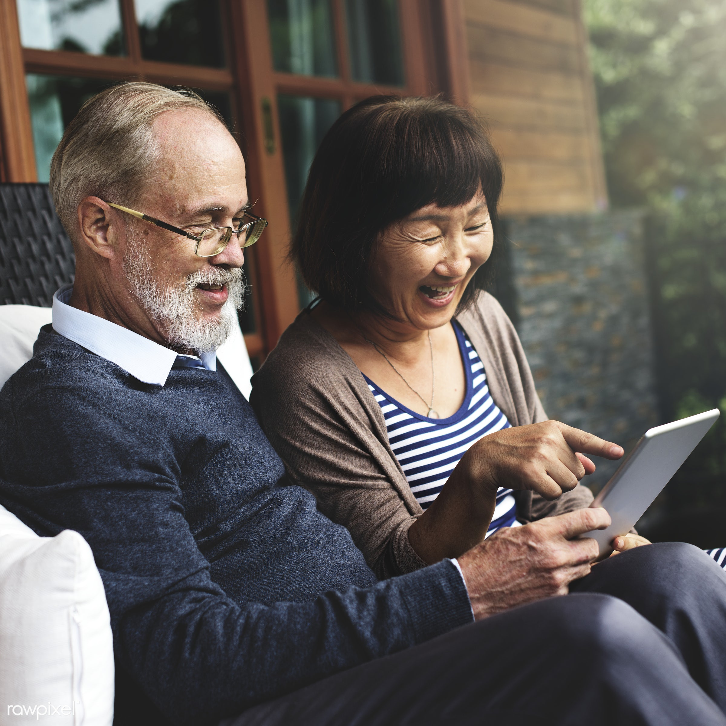 Senior couple using a tablet together - senior, retirement, asian, autumn, communication, couple, digital, fall, happiness,...