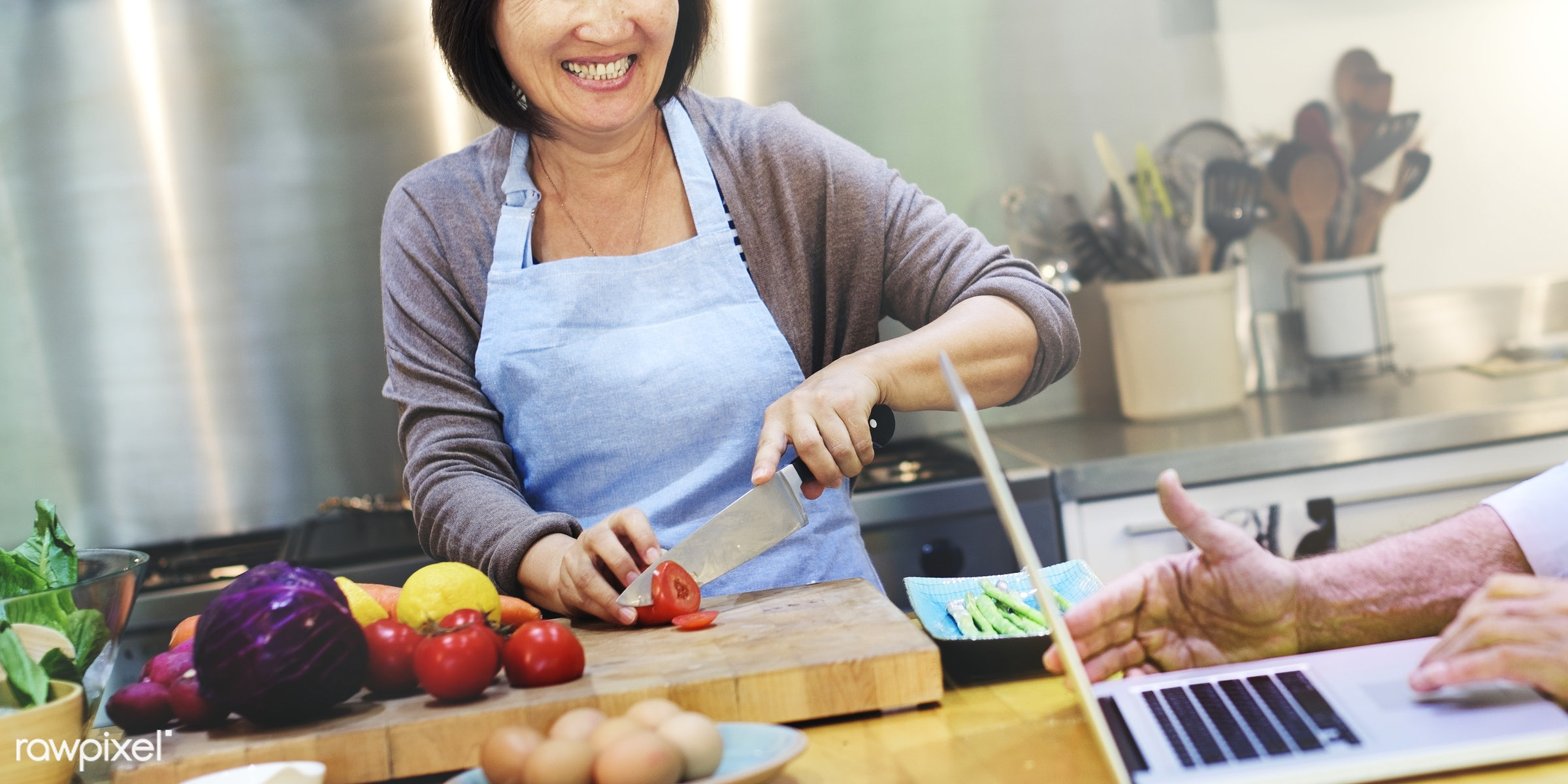 Asian woman cheerfully cooking in the kitchen - cooking, food, frying, home, housework, kitchen, mature, old, senior, stove...