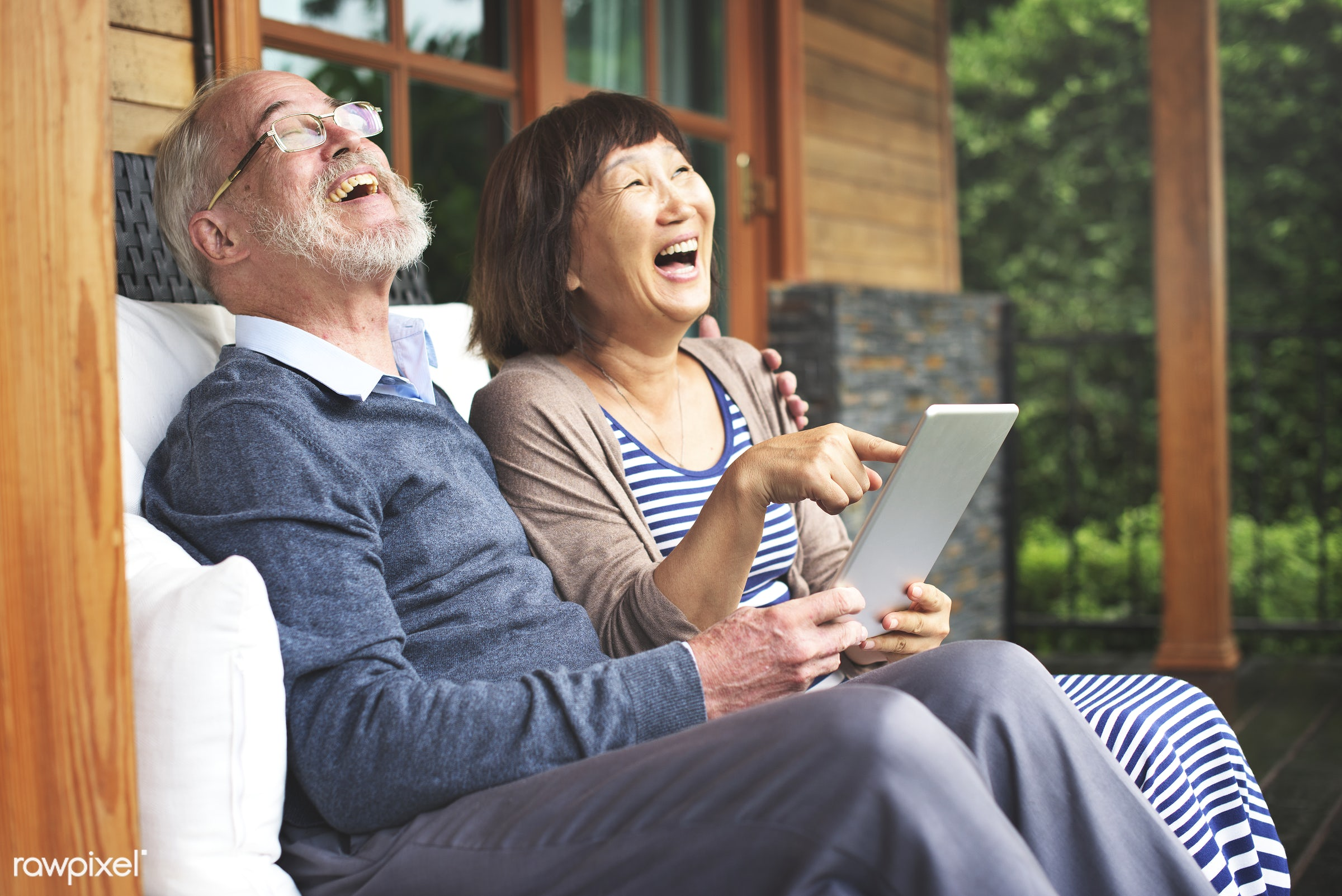 Happily retired husband and wife on a tablet - house, digital, happy, couple, laughing, senior, adult, asian ethnicity,...