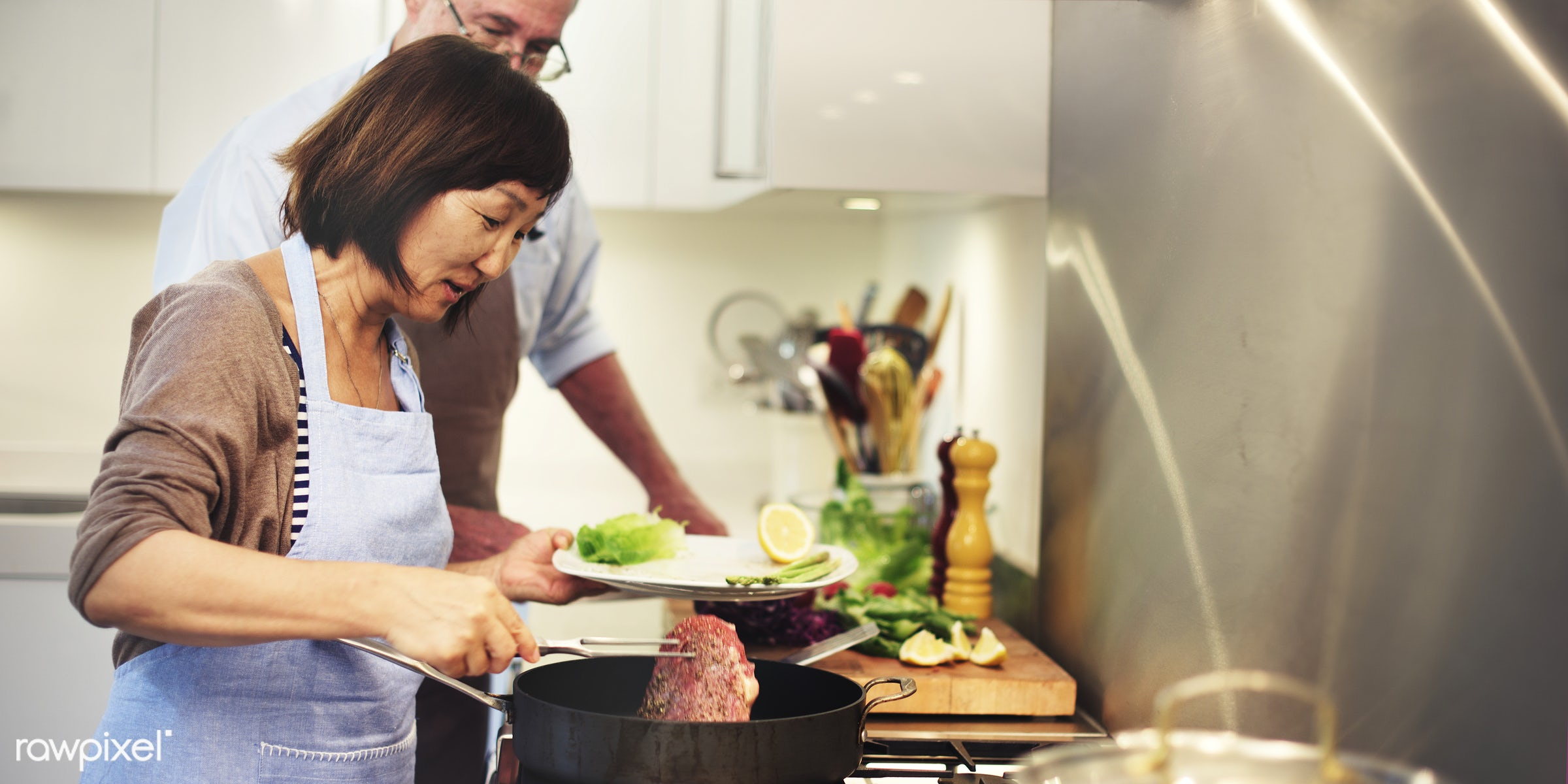 Senior couple cooking in the kitchen - cooking, kitchen, food, together, togetherness, couple, home, housework, frying,...