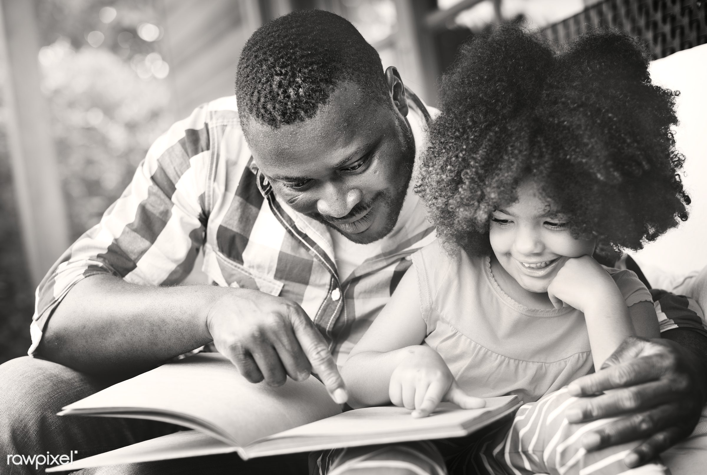 Dad and his daughter reading a book - african, black, african american, mixed race, family, happiness, together, love, home...