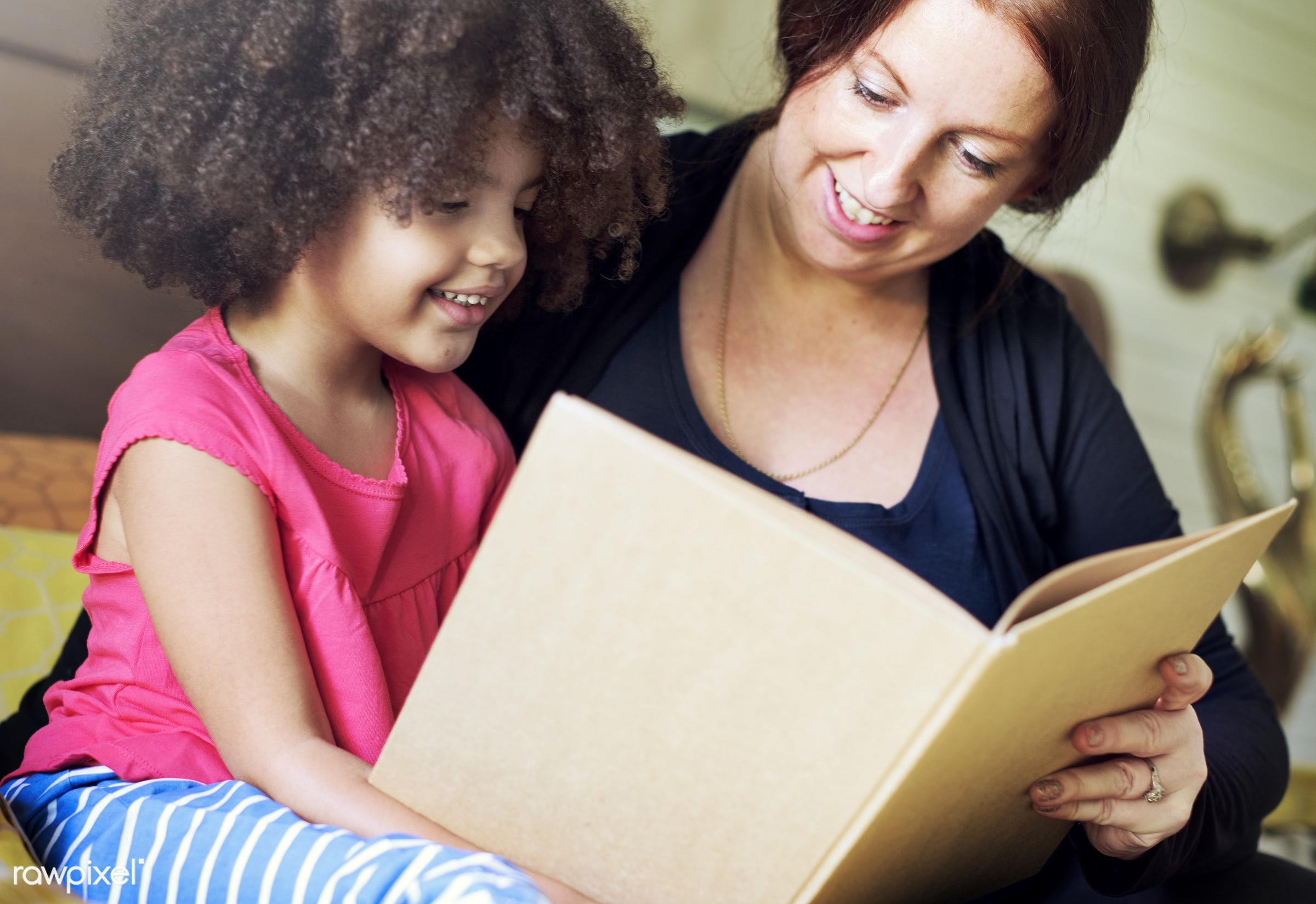 Mother reading with her daughter - book, education, family, story, teaching, african, african american, afro, bedroom,...