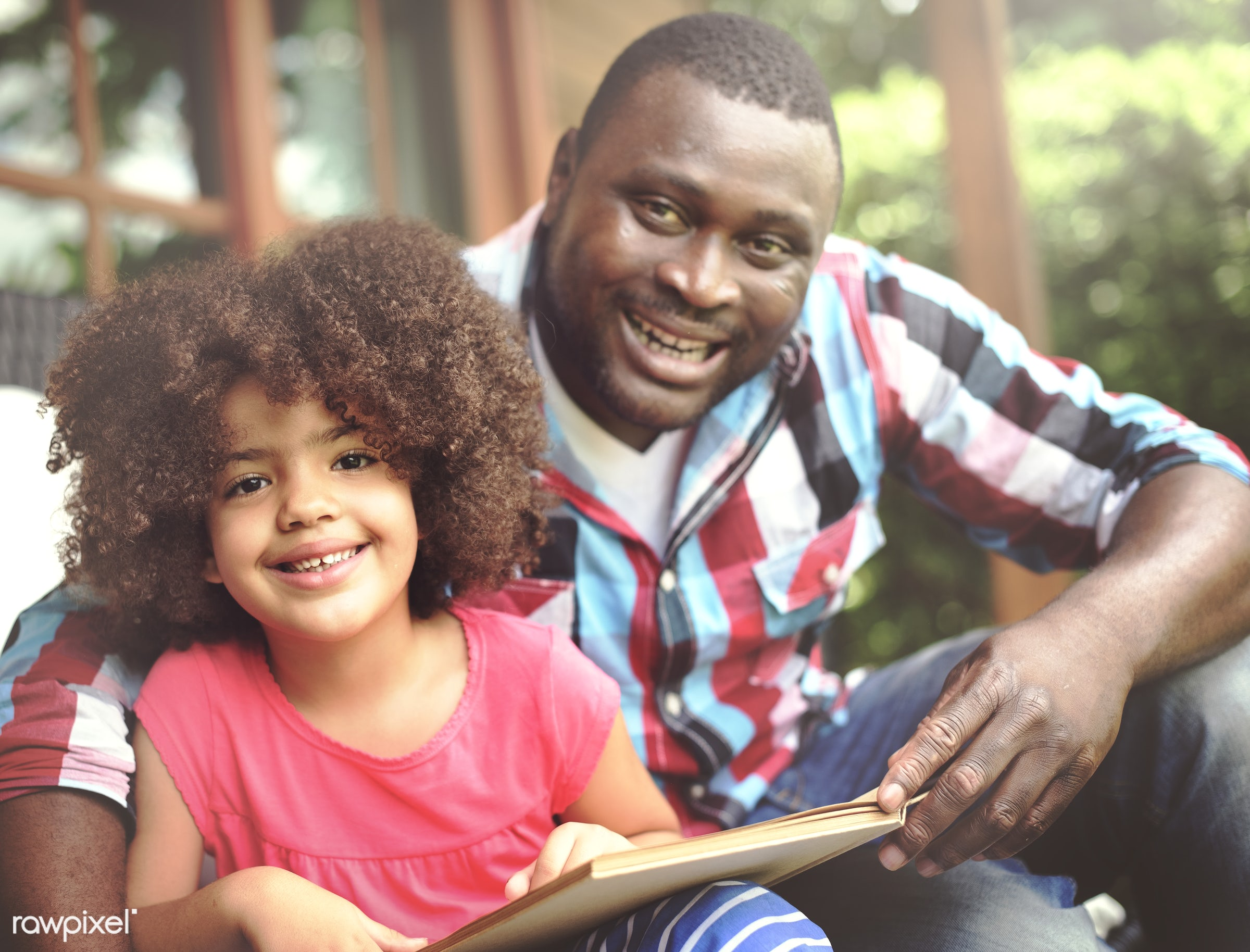 Dad and his daughter reading a book - african, black, african american, mixed race, activity, african descent, bonding, book...