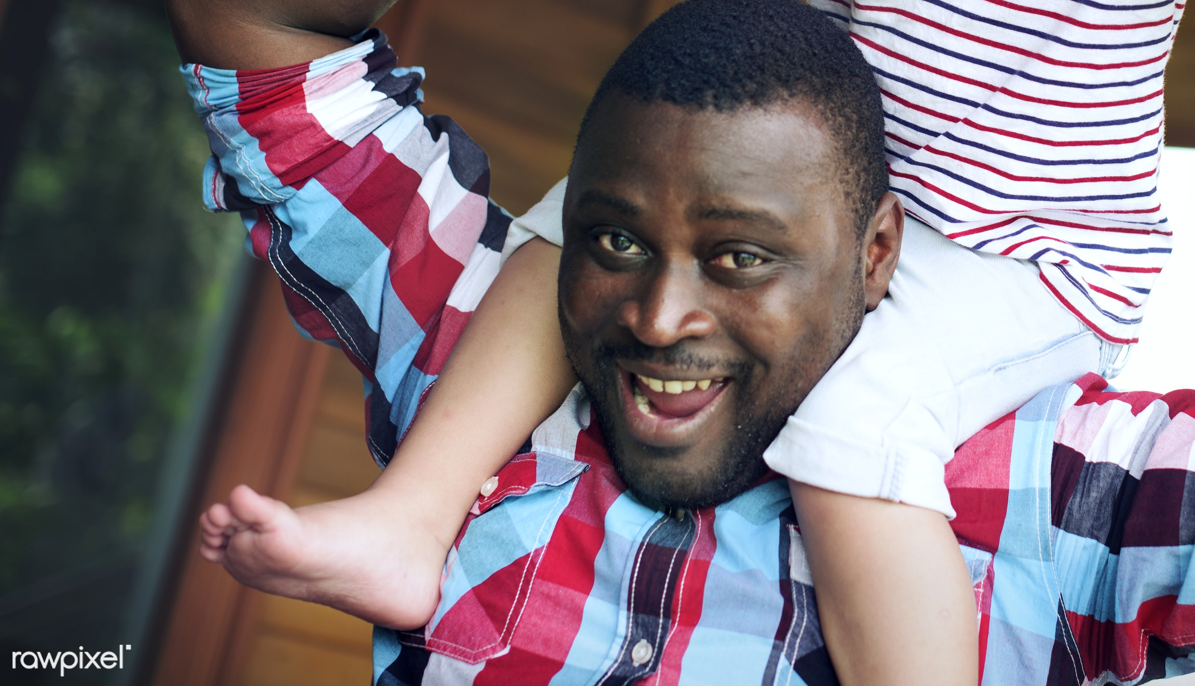 Happy African American father giving his kid a piggyback ride - african, african american, black, daughter, father, fun,...