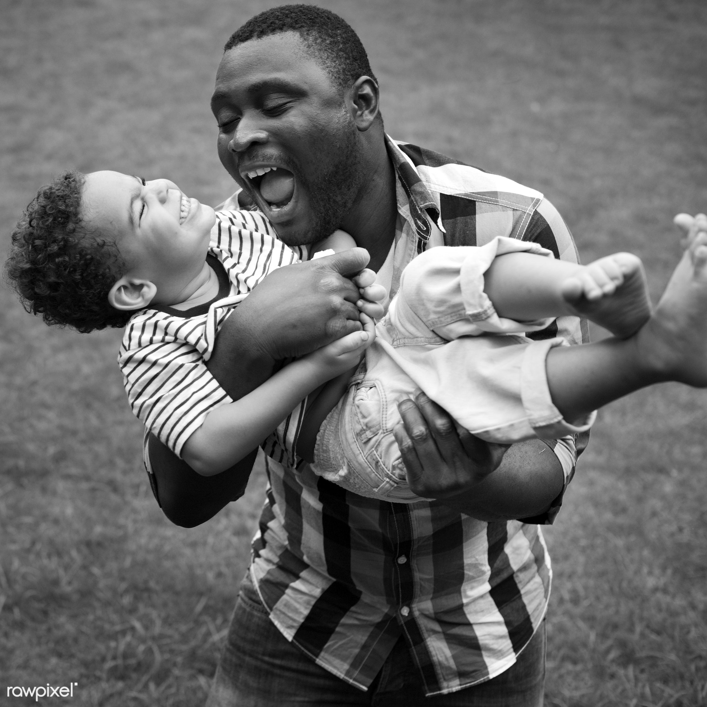 Dad playing with his son - family, love, african, african american, black, fun, happiness, home, mixed race, together