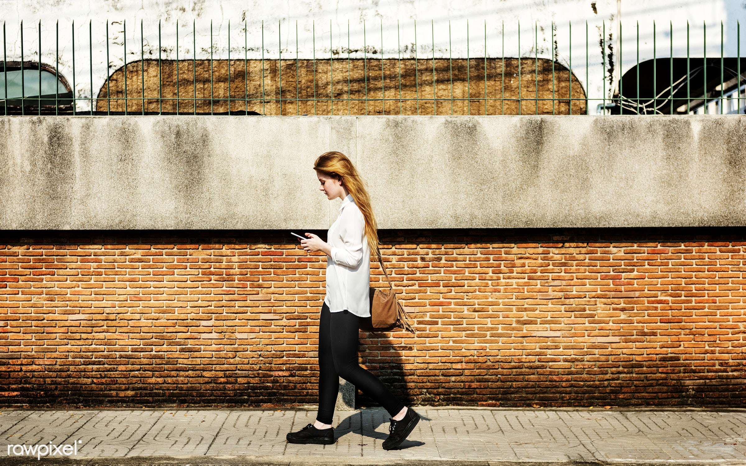 Browsing Social Media Walking Online Relax Concept - woman, alone, cellphone, cheerful, communication, connection, device,...