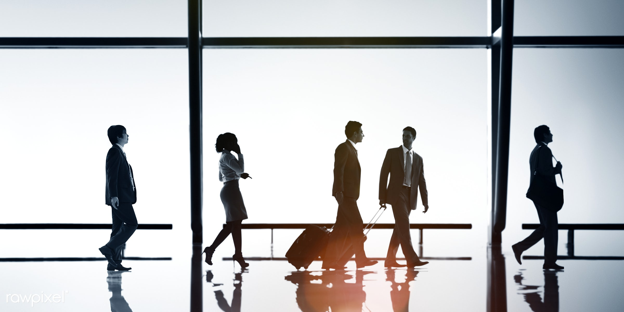 Business people on the move - backlit, blue, business, business people, business travel, businessmen, businesswomen, calling...