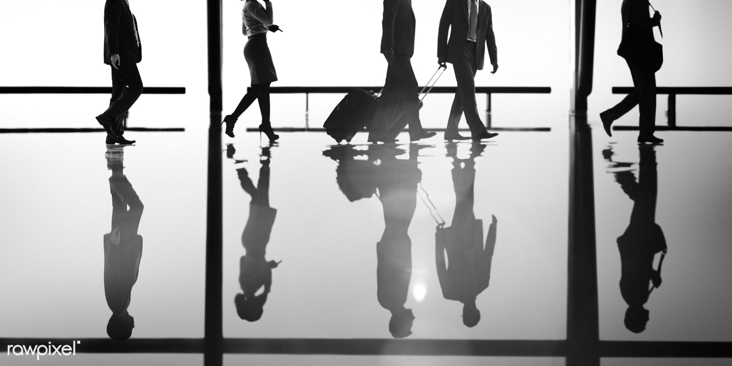 Corporate business travel - backlit, blue, business, business people, business travel, businessmen, businesswomen, calling,...