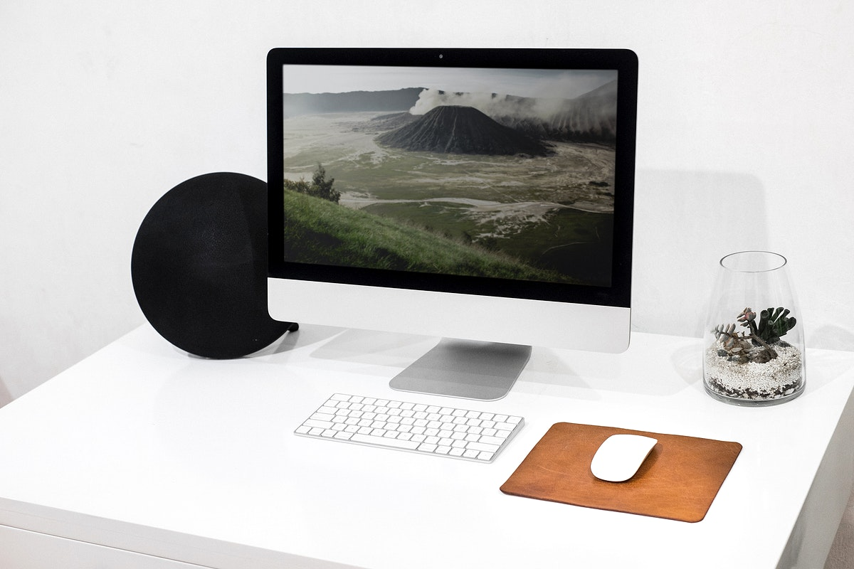 Clean modern workspace with travel inspiration