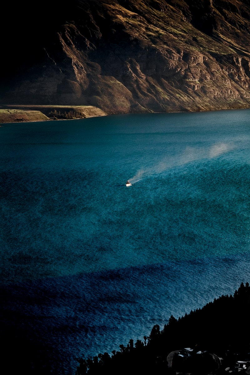 Blue water and rocky shores near to Queenstown, New Zealand