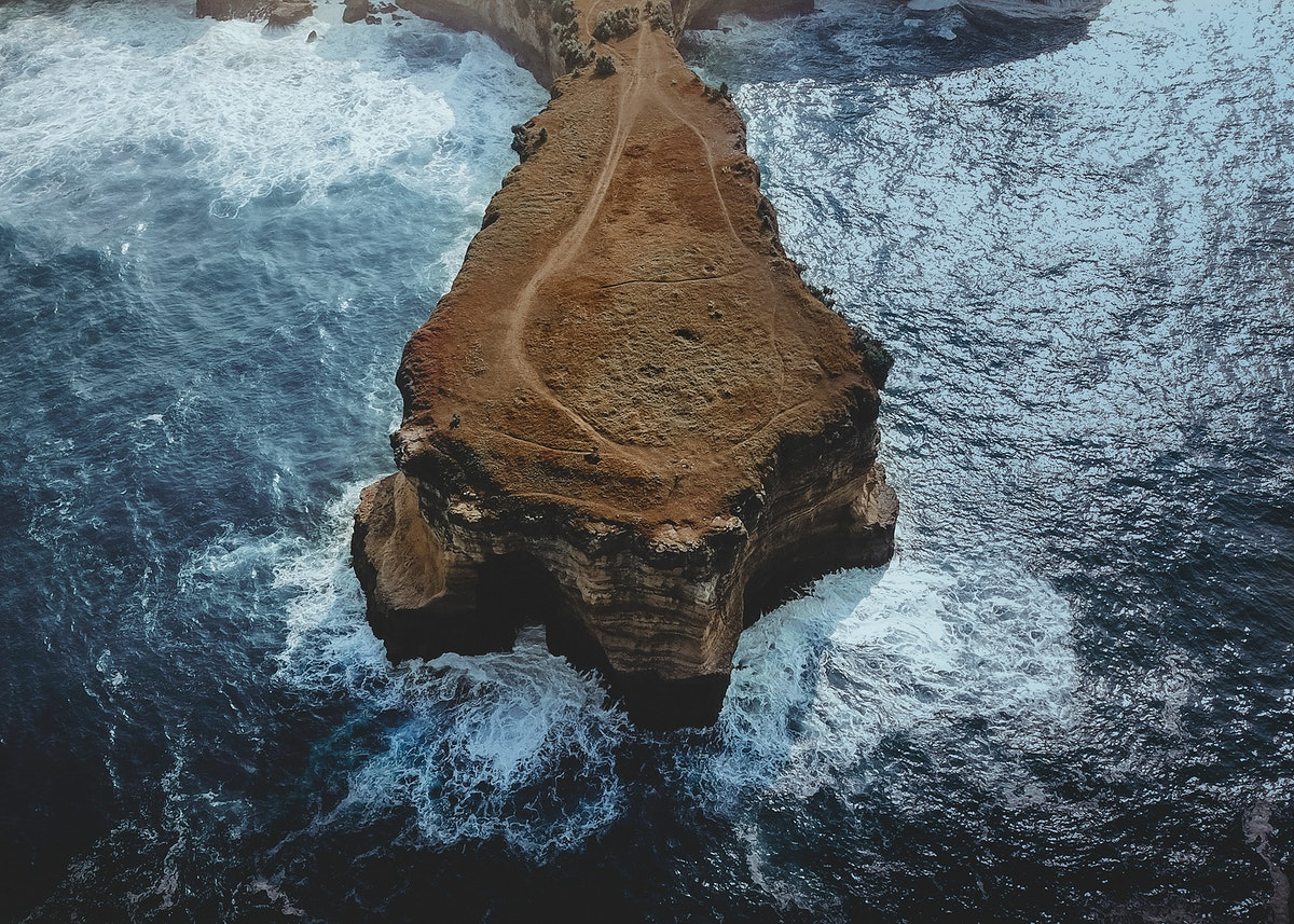 Cliffs among the blue Indian Ocean in Pacitan, Indonesia
