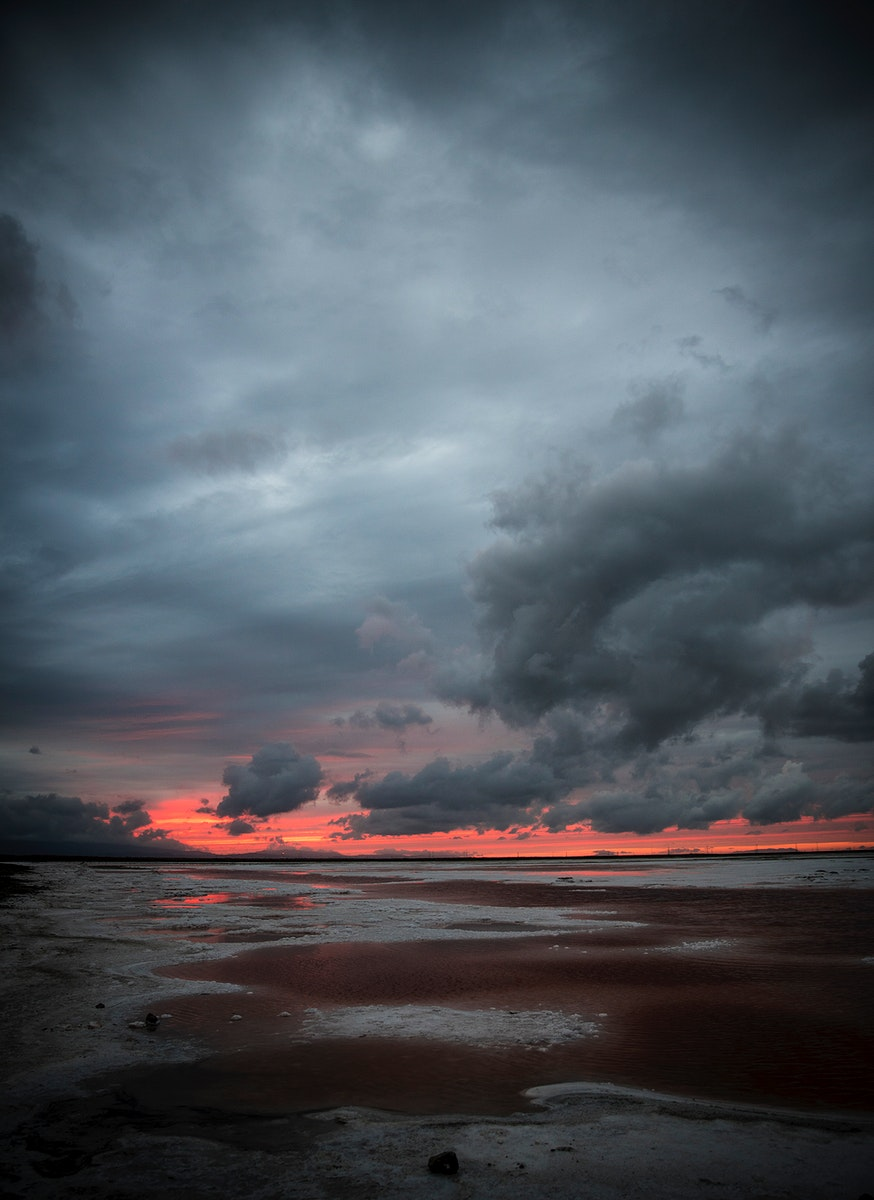 Dramatic sky and sunset over the water